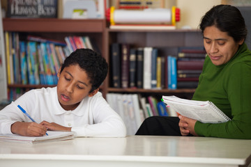 Hispanic Mom and Boy in Homeschool Setting
