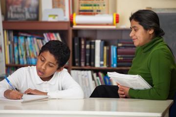Hispanic Mom and Boy in Home-school Setting