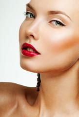 young beautiful woman. perfect skin. red lipstick.