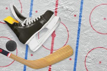 Hockey skates, stick and puck