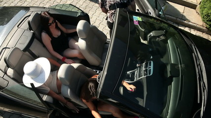 Shot from bird perspecitve of women getting out of the car