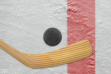 Puck and stick on the red line