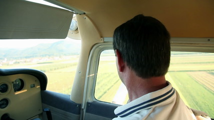 Copilot in airplane watching around
