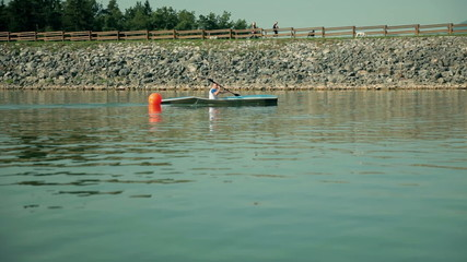 Kayaker passing a marker in river