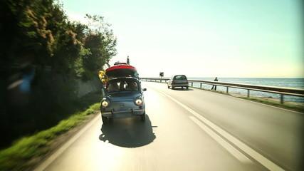 Family driving across a beautiful landscape near sea