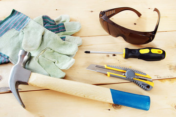 Some working tools with protective gloves and glasses