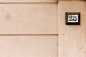 a street-number above the wall