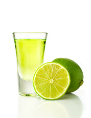 Tequila shot with lime isolated on white background