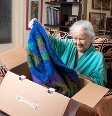 Old woman getting out a present