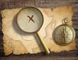 aged antique nautical compass and magnifying glass on table with - 77521419