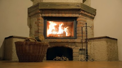Front shot of a basket and heavy fire inside fireplace