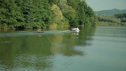 Professional kayaker tracking motor boat