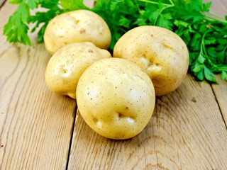 Potatoes yellow with parsley on wooden board