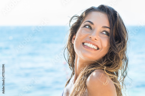 Happy woman at beach - 77525094