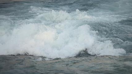 Shot of kayaker in wild waters struggling