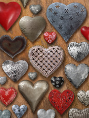Assorted hearts on wood background