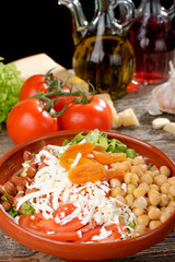 Salad with chickpeas, tomato, cheese and dried apricots