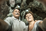 Senior happy couple taking a selfie at Tham Phum Cave in Laos