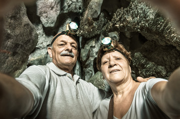 Senior happy couple taking a selfie at Tham Phum Cave in Laos