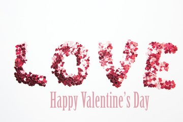 Composite image of pink confetti spelling out love