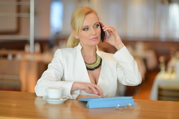 Successful and atractive middle aged woman chatting on the phone