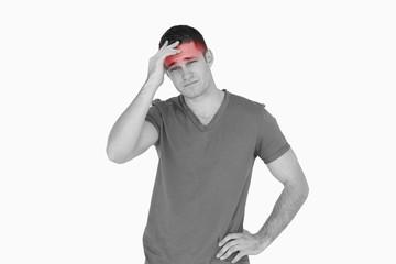 Young man having a headache