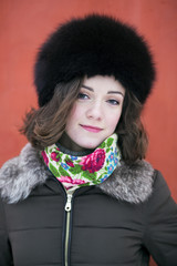 Female portrait on a red background