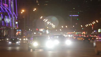 Steam of cars on the night street of the big city