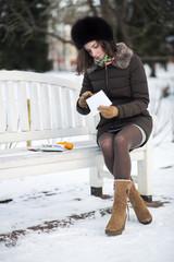 Woman openes an envelope