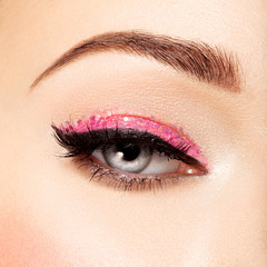 Woman's eye with pink eye makeup