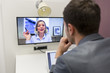Leinwanddruck Bild - Businessman on video conference with her colleague in office job