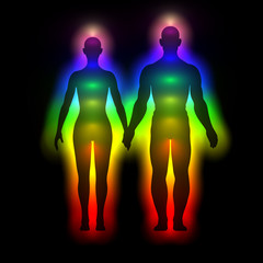 Rainbow silhouette of woman and man with aura