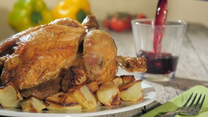roast chicken and pouring red wine