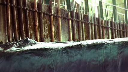Close up and fast version of small artificial waterfall and kayaker