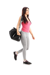 Athlete walking and carrying a sports bag