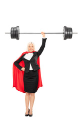 Full length portrait of a female superhero lifting a barbell