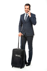 businessman with trolley talking on the phone