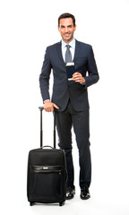 businessman with trolley and holding his passport