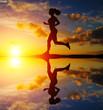 Running girl at sunset silhouette