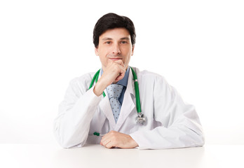 Thoughtful male doctor with hand on chin