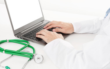 Doctor using laptop close up