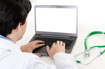 Rear view of a male doctor with laptop