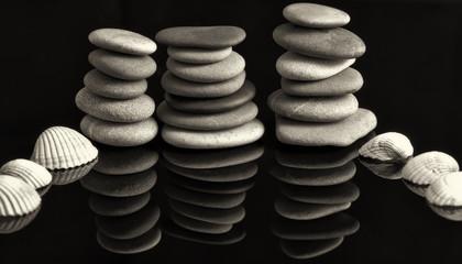 Garden of stones: Sea stones laid in piles reflected