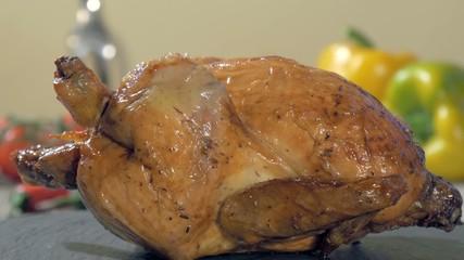 roast chicken on stone plate rotating