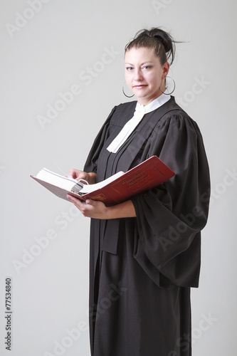 Holding a book of law - 77534840