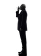 senior business man smoking electronic e-cigarette silhouette