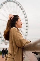 Girl combing her Hair on a Pier