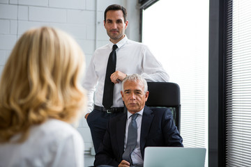 Three businesspeople having a meeting