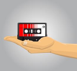 Hand holding an audio casette