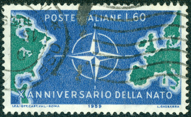 stamp shows Map of North Atlantic and NATO Emblem